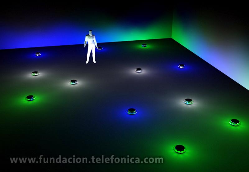 """""""Espacio cambiario"""" – Leo Núñez, Premio MAMba- Fundación Telefónica - Instalación robótica que se desarrollará dentro de un espacio oscuro. Una colonia de robots se ubicará sobre el piso y cada robot poseerá un aura lumínica. Estos poseerán en su programación un comportamiento territorial, pero su nivel de agresividad variará en relación a la cotización de la moneda que representen en el mercado cambiario. Para ello la instalación consta de un sistema computacional, conformado por un hardware y un software."""